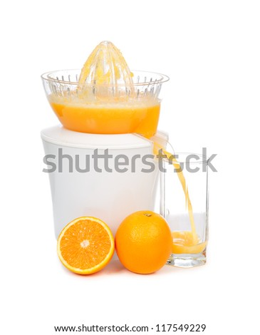 Preparing fresh orange juice squeezed with electric juicer on a white background - stock photo