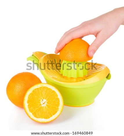 Preparing fresh orange juice squeezed with hand juicer isolated on white