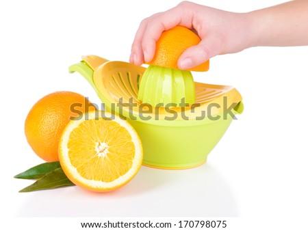 Preparing fresh orange juice squeezed with hand juicer isolated on white - stock photo