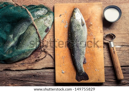 Preparing freshly caught dinner - stock photo