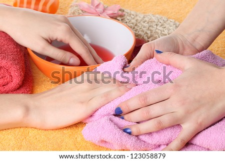 Preparing hands for a manicure, beauty salon - stock photo