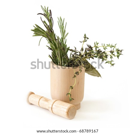 Preparing herbs in a mortar and pestle. - stock photo