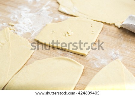 preparing homemade pasta for lasagna and tagliatelle, flour, eggs, water and salt. - stock photo