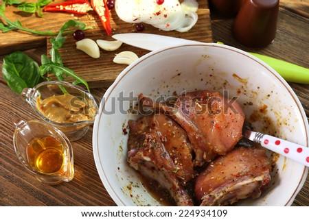 Preparing lamb chops - stock photo