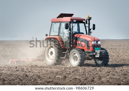 preparing land for sowing in spring - stock photo