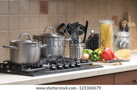 Preparing lunch for the family. Cooking in a kitchen. - stock photo