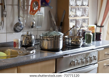 preparing lunch for the family. cooking in a modern kitchen. - stock photo