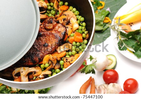 Preparing meat and vegetables for lunch, very delicious and good looking - stock photo