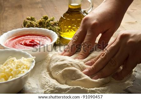 Preparing pizza dough - stock photo
