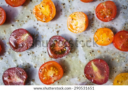 Preparing roasted tomatoes from cherry tomatoes - stock photo