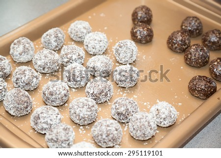 Preparing sweet Indian burfi treats with selective focus - stock photo