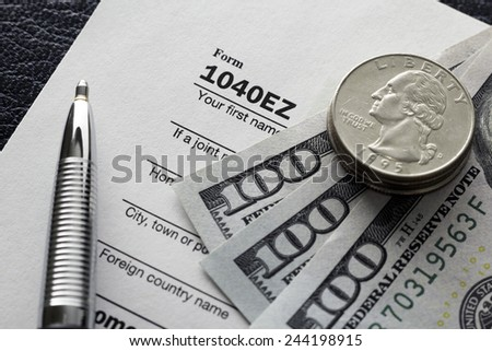 Preparing tax papers. - stock photo
