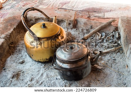 preparing tea in Bedouin camp  - stock photo