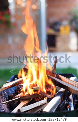 preparing the fire for barbecue/grilling meat in the backyard.  - stock photo