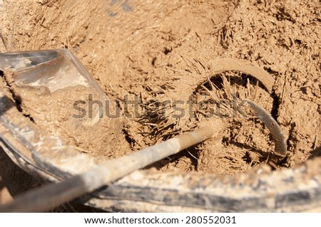 Preparing the mass for natural clay plasters - stock photo