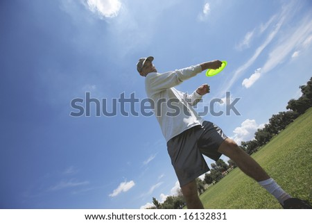 Preparing to throw a disk at a disk golf course in a park. - stock photo