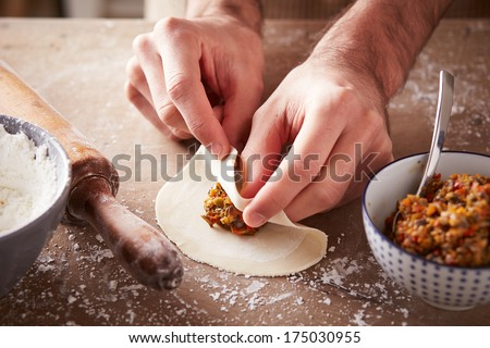 Preparing vegetable dim sums chinese dumplings - stock photo