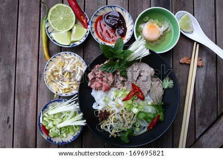Preparing Vietnamese rice noodles, with beef and other materials - stock photo