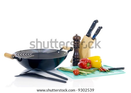 Preparing wok with fresh vegetables on cuttingboard, white background, - stock photo
