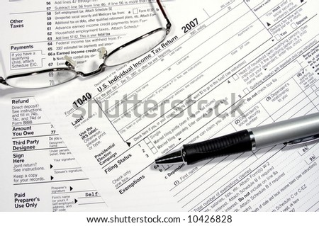 Preparing your own tax return with glasses and pen