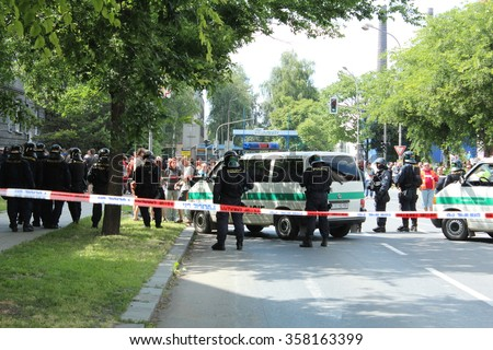 PREROV, CZECH REPUBLIC, JUNE 25, 2011: Police protect ghetto in Prerov, street Husova with residents people Gypsies, Europe, EU