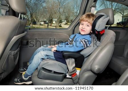 Preschool age boy in a booster seat - stock photo