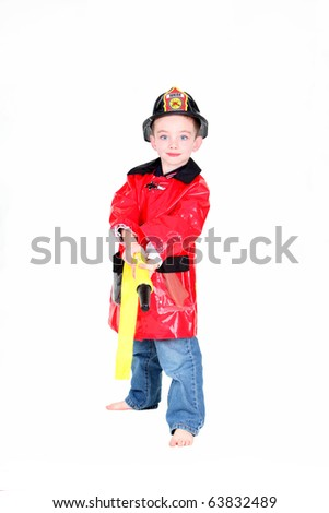 Preschool age boy in fireman costume with hose on white background - stock photo