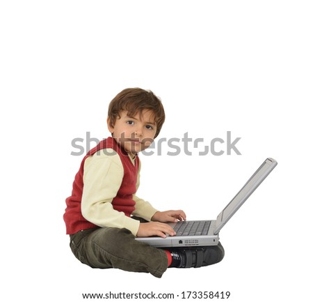 Preschool Age Boy Looking at Camera Sitting with Laptop isolated on white background