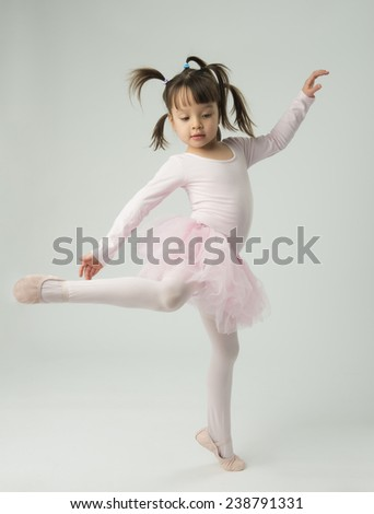 preschool age girl dancing and wearing a ballet tutu - stock photo
