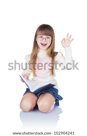 Preschool age girl wearing eyeglasses with okay gesture, isolated on white background - stock photo