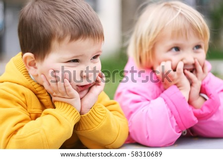 Preschool boy and girl looks ridiculous - stock photo