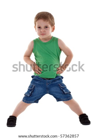 preschool boy posing for kids fashion show over white