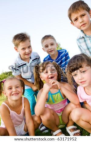 Preschool boys and girls laughing - stock photo