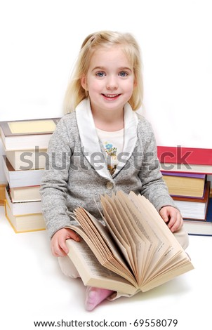 preschool child with books white background - stock photo