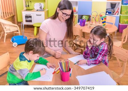 preschool classroom teacher with kids - stock photo
