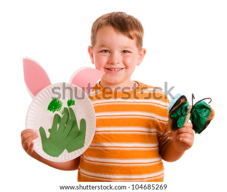 Preschool education concept with child showing off his art projects isolated on white - stock photo