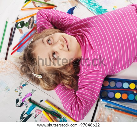Preschool girl drawing - stock photo