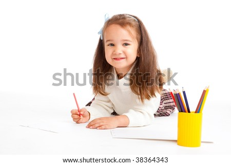 Preschool girl drawing on the floor