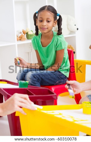 preschool girl in classroom - stock photo