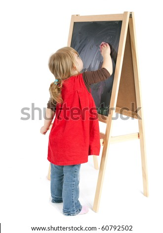 preschool girl in red dress drawing on blackboard - stock photo