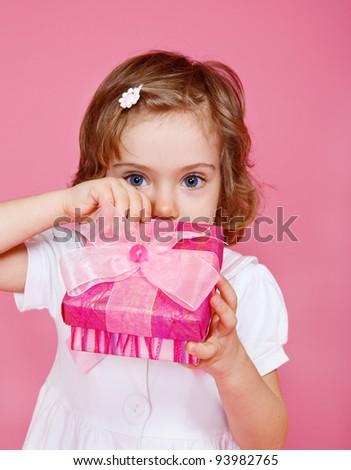 Preschool girl opening present box - stock photo