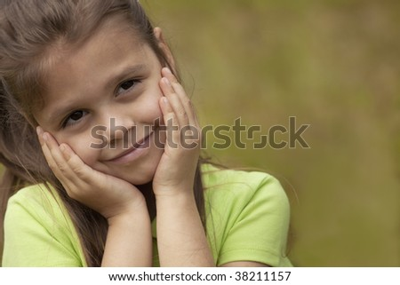 Preschool Girl with hands on Face. - stock photo