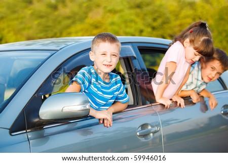 Preschool kids in the car - stock photo