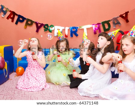 Preschool kids with soap bubbles at the birthday party - stock photo