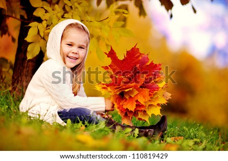 preschool little girl with autumn leaves in the beauty park - stock photo