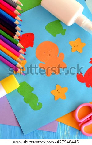 Preschool sea animals arts and crafts. Paper ocean animals. Children application from color paper make in kindergarten. Early childhood education. Pencils, glue, scissors. Kids background  - stock photo