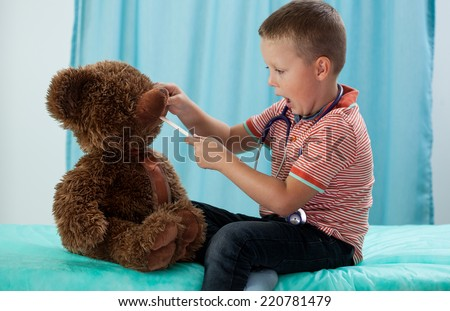 Preschooler and his teddy bear at pediatrician - stock photo