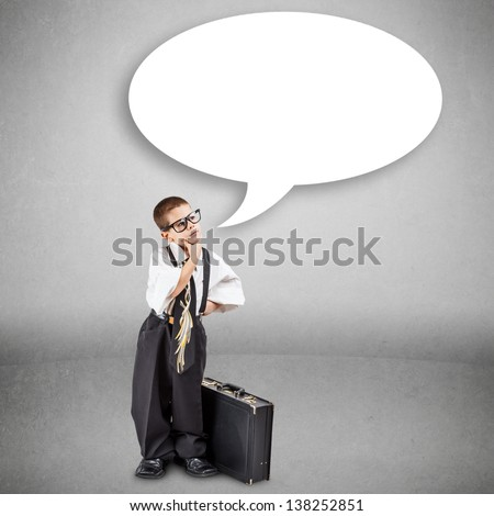 Preschooler boy in an adult business suit thinking - stock photo