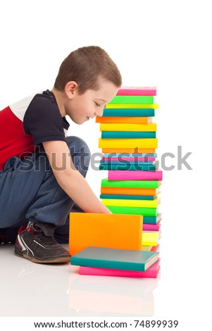 preschooler boy playing with books, isolated on white