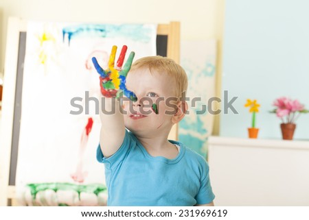 Preschooler Boy With Painted hand - stock photo